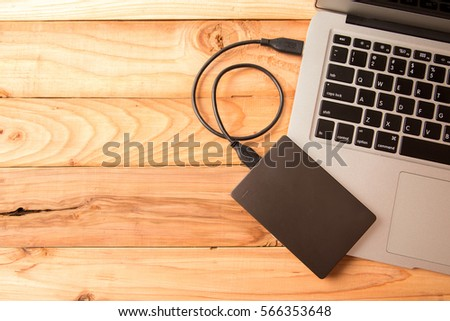 external Hard with Laptop on wooden background