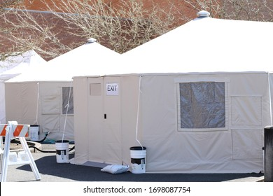 External hospital tents on hospital property, preparing for in-coming patients during a pandemic.