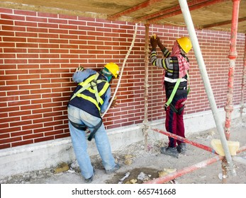 External refractory tile cleaning by labors /Full body harness wearing with personal protective equipment