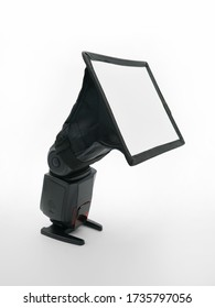 External speedlight with and diffuser isolated on white background