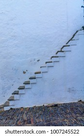An external staircase in the historic village of Monsaraz, Portugal