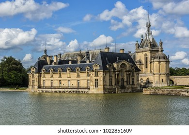 External view of famous Chateau de Chantilly (Chantilly Castle, 1560). Chantilly Castle - a historic chateau located in town of Chantilly, Oise, Picardie, France.