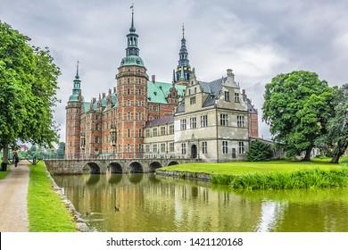 External view of Frederiksborg Castle (Frederiksborg Slot, XVII century) - palace in Hillerod, Denmark. Renaissance Frederiksborg castle reflected in the lake in Hillerod, (near Copenhagen).