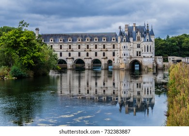 External view of Medieval Chateau de Chenonceau (1522) with reflection in the River Cher. Chenonceau, Loire Valley, France.