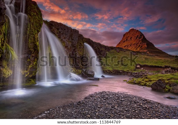 Extinct volcano in Iceland (Island). Sunset at Mount Kirkjufell (Church mountain) in the Snaefellsnes peninsula, Iceland, complimented by a beautiful waterfall.