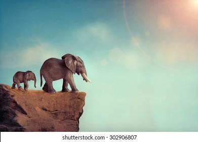 extinction concept elephant family on edge of cliff