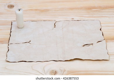 extinguished the candle on paper laid on the table