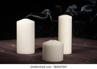 Extinguished candle on a wooden table
