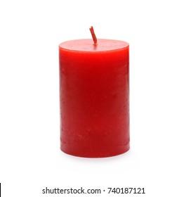 Extinguished red candle isolated on white background