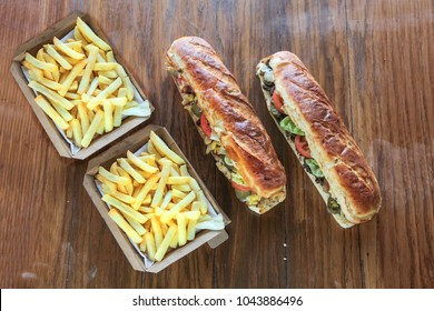 Extra large mighty sandwiches with box of potato french fries meal for two