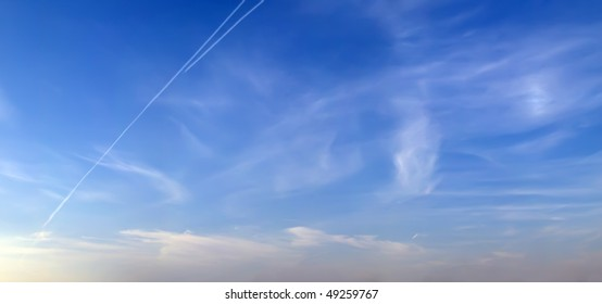 extra large panorama image of cirrus clouds on blue sky