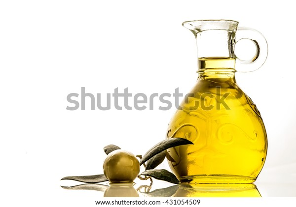 Extra virgin olive oil glass jar and olive isolated on white background