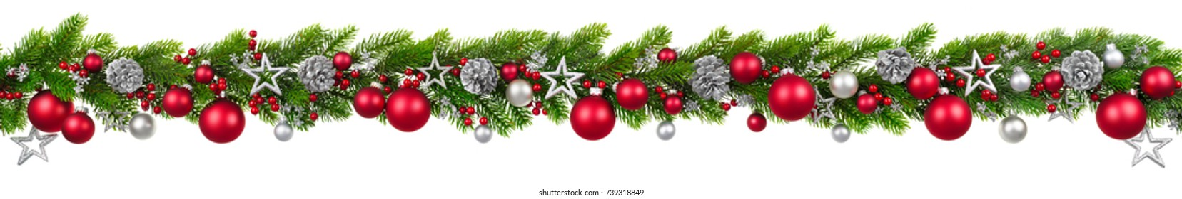 Photo of Extra wide Christmas border with hanging garland of fir branches, red and silver baubles, pine cones and other ornaments, isolated on white