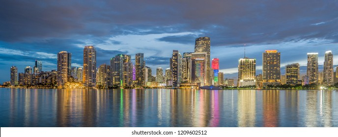 Extra wide panorama of business MIAMI skyline in the evening