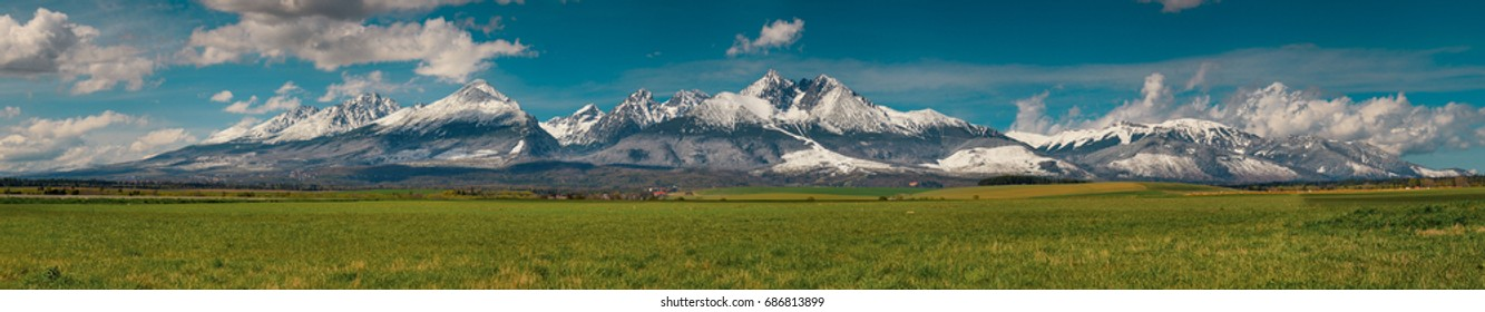 Extra wide panorama of High Tatras mountains during April with snowy hills / Vysoke Tatry / Slovakia
