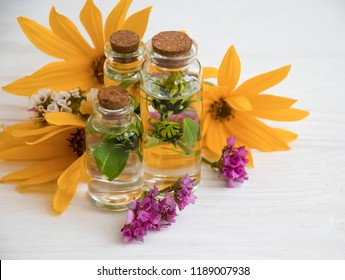 extract, flowers, ingredient on a white wooden background