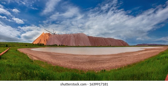 Extracting and mining potassium and magnesium salts.Large excavator machine and Huge mountains of waste ore in the extraction of potassium. Belarus, Soligorsk.