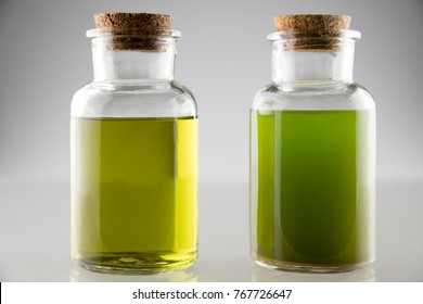 extraction of cannabis oil and ethanol alcohol in 2 laboratory glass bottles ,in  first is unfiltered oil and ethanol and in second is with filtered mix