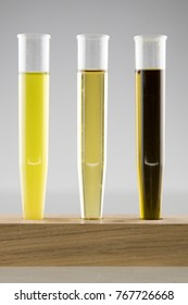 extraction of cannabis oil and ethanol alcohol in 3 test tubes,in  first unfiltered oil and ethanol, second is with filtered mix and third is with high concentration of cannabis oil, vertical