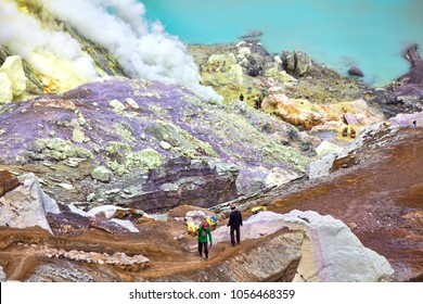 Extraction of sulfur in a  Ijen volcano, workers lift on the top of a basket with sulfur. Volcano crater. East Java, sulfuric lake of Kawah Ijen Mountain's cauldron, Indonesia