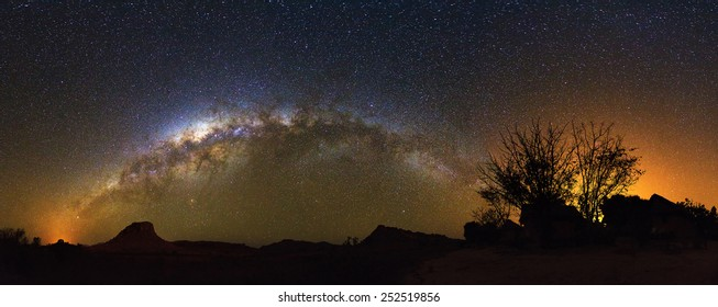 Extraordinary 180 degree nightscape panorama with the milky way seen from Isalo, Madagascar