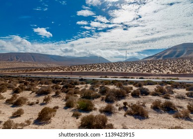 extraordinary panorama of the desert with mountains of volcanic lava on the Canary Island of Fuerteventura