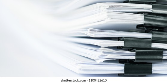 extreamely close up a  report paper stacking of office working document