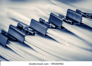 extreamely close up  stacking of office working document with paper clip folder