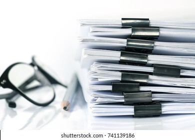 extreamely close up  stacking of office working document with paper clip folder, vintage color tone
