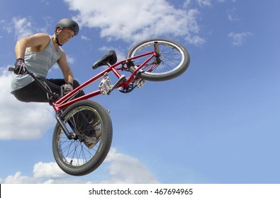 Extreme Athlete - BMX Bicycle trick in a skateboard park tail whip