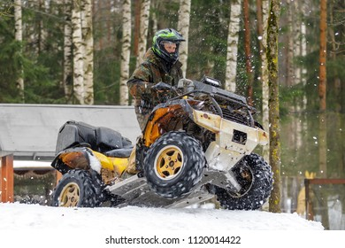 Extreme ATV rider gets on snow hill