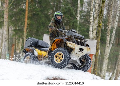 Extreme ATV riding down the snowy hill
