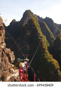 Extreme bicycle tightrope in a stunning national park China