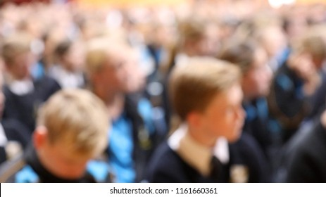 Extreme blur of students at assembly. anonymous school children faces in a crowd at a high school eductational institution. education teacher teaching concept.