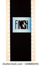 Extreme close up of 35mm movie film strip with finish text message on frame