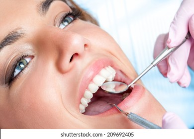 Extreme close up of beautiful young girl having dental check up.