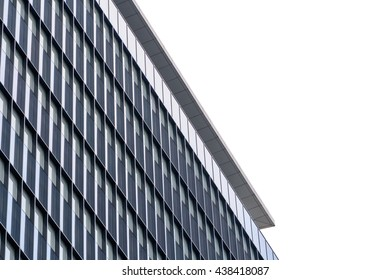 Extreme close up building windows texture. Low angle view of modern commercial office building with vertical windows, architectural exterior against white sky.