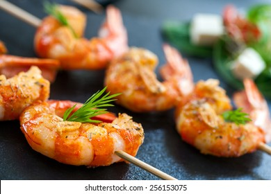 Extreme close up detail of appetizing queen prawn brochette.