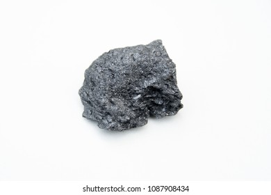 extreme close up with a lot of details of graphite mineral isolated over white background