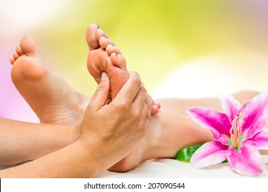 Extreme close up of female Spa therapist doing foot massage.