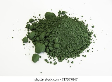 extreme close up of green pigment called Chromium oxide isolated over white background