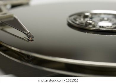 Extreme close up of hard drive platters and head