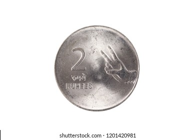 An extreme close up of an Indian two rupee coin on a solid white background