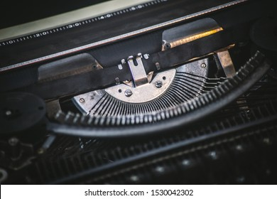 Extreme Close Up of an Old Typing Machine with QZERTY, a traditional typewriter keyboard layout used mostly in Italy. Vintage background. Concept: Letterpress printing and electromechanical machine