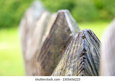 Extreme close up on a wooden fence with shallow depth of field. Strength and might concept.