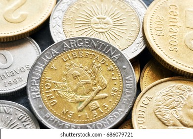 Extreme close up picture of Argentine peso, shallow depth of field.