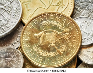 Extreme close up picture of Guatemalan quetzal coins, shallow depth of field.