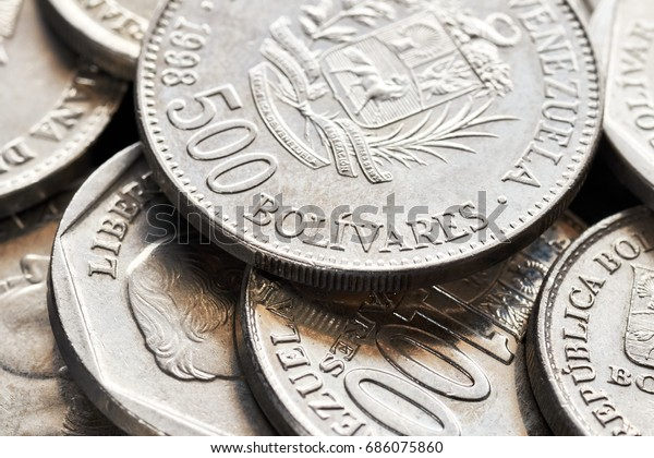 Extreme close up picture of old Venezuelan bolivar coins, shallow depth of field.