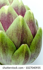 Extreme close up of purple artichoke with white background in natural light