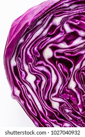 Extreme close up of purple cabbage head on white background in natural light